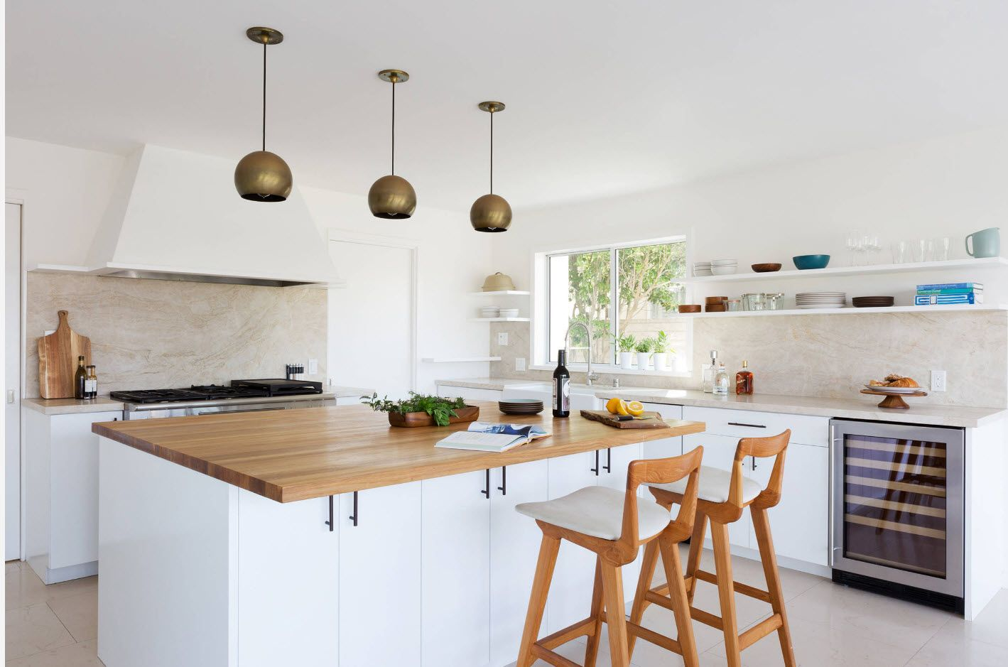 40 Square Feet Kitchen Modern Dedign Ideas & Layout Types. Light wooden kitchen tabletop and bar stools with white atmosphere and suspended round gold lamps