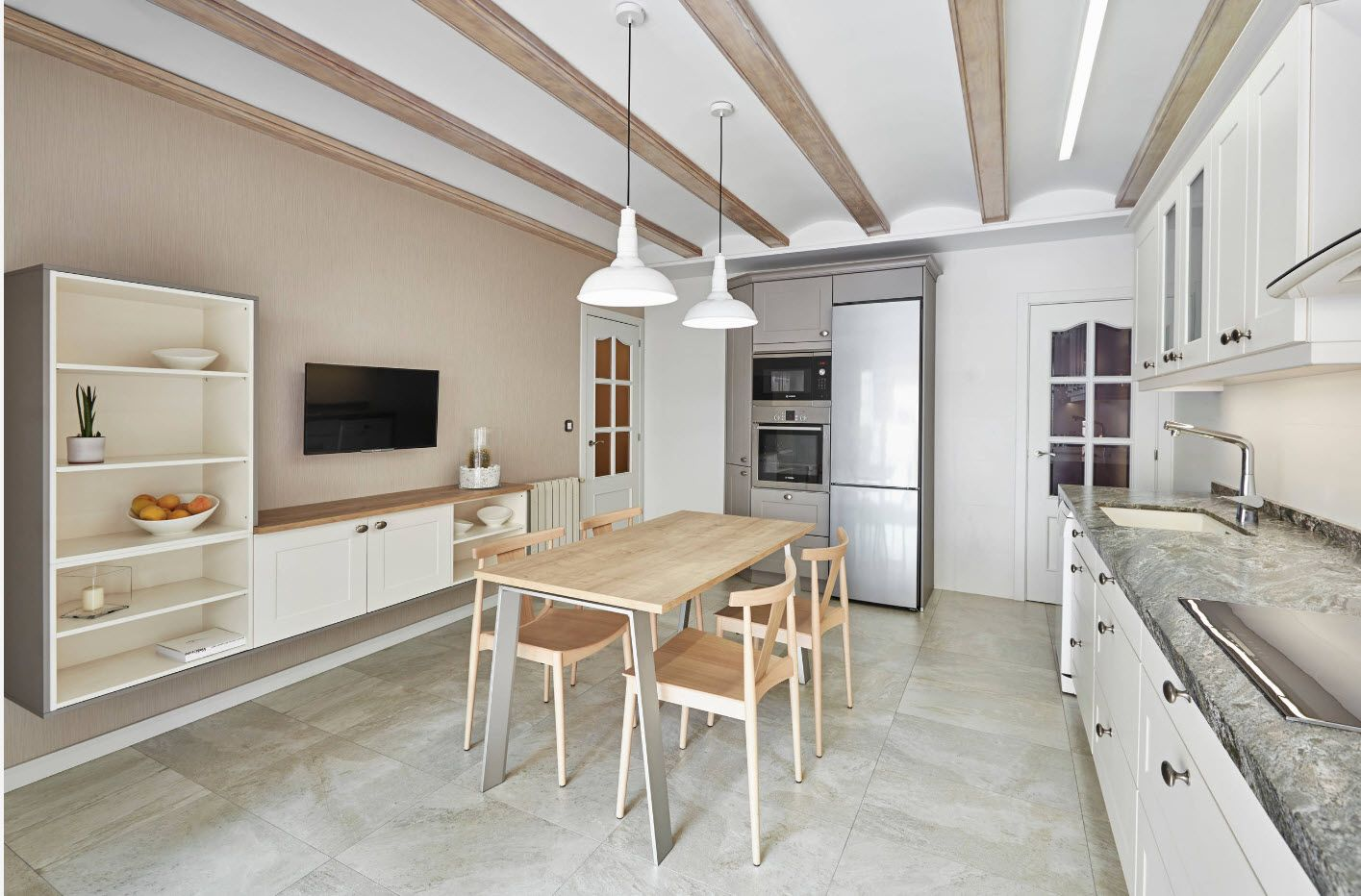 Fresh Scandi style wooden furniture and the open beams at the large dining room