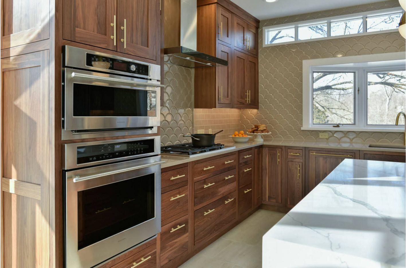 Wooden nobility in dark styled modern kitchen