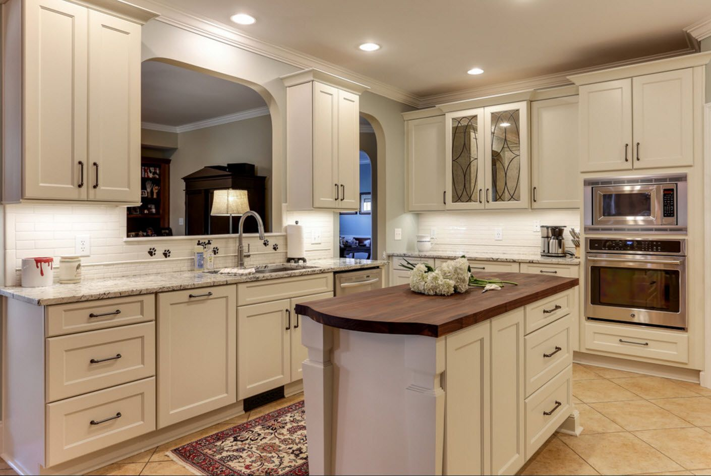 French classic style in the kitchen with wooden kitchen furniture and island