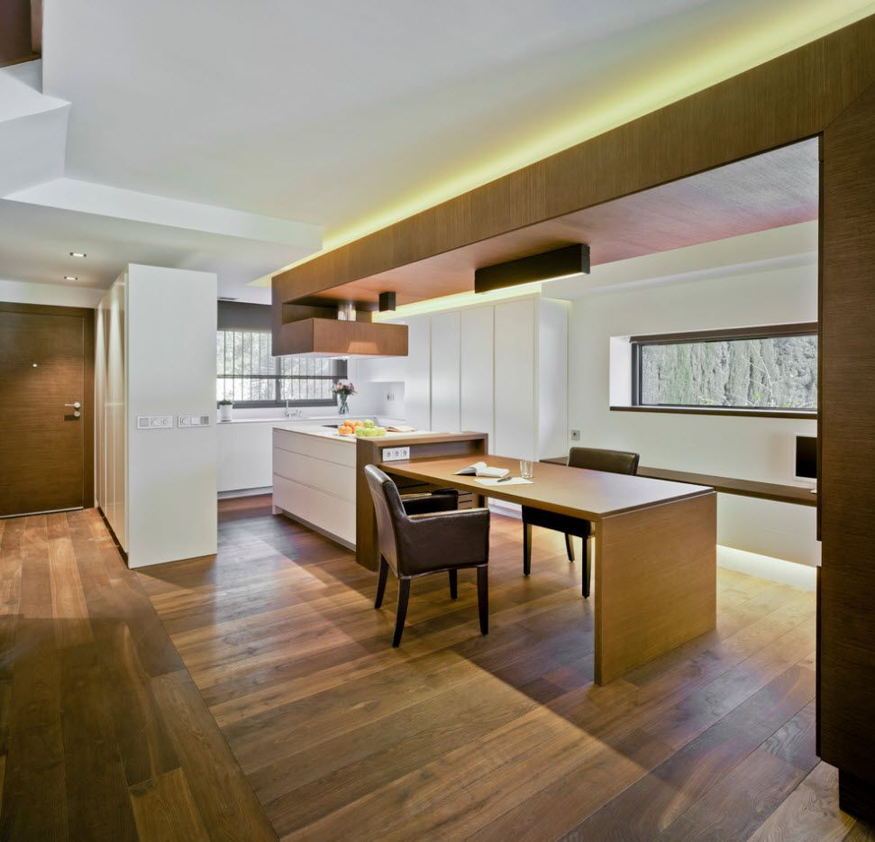 totally wooden trimmed kitchen with dining zone at the large first floor of the cottage