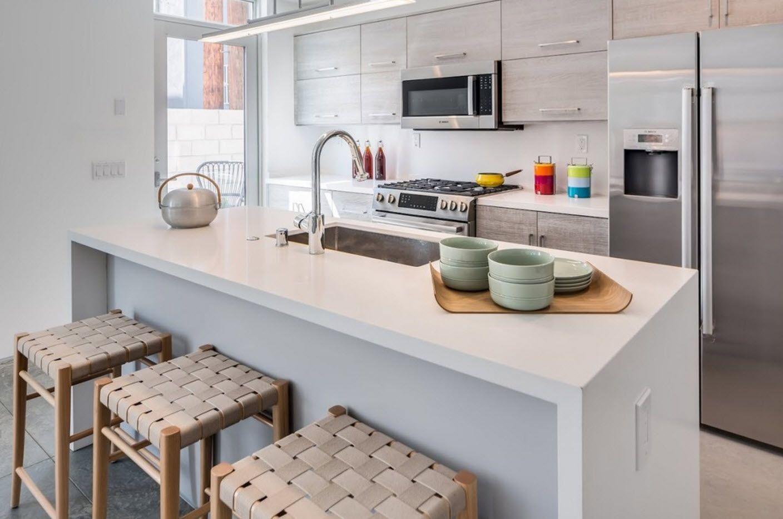 Elongated sink for modern white kitchen island