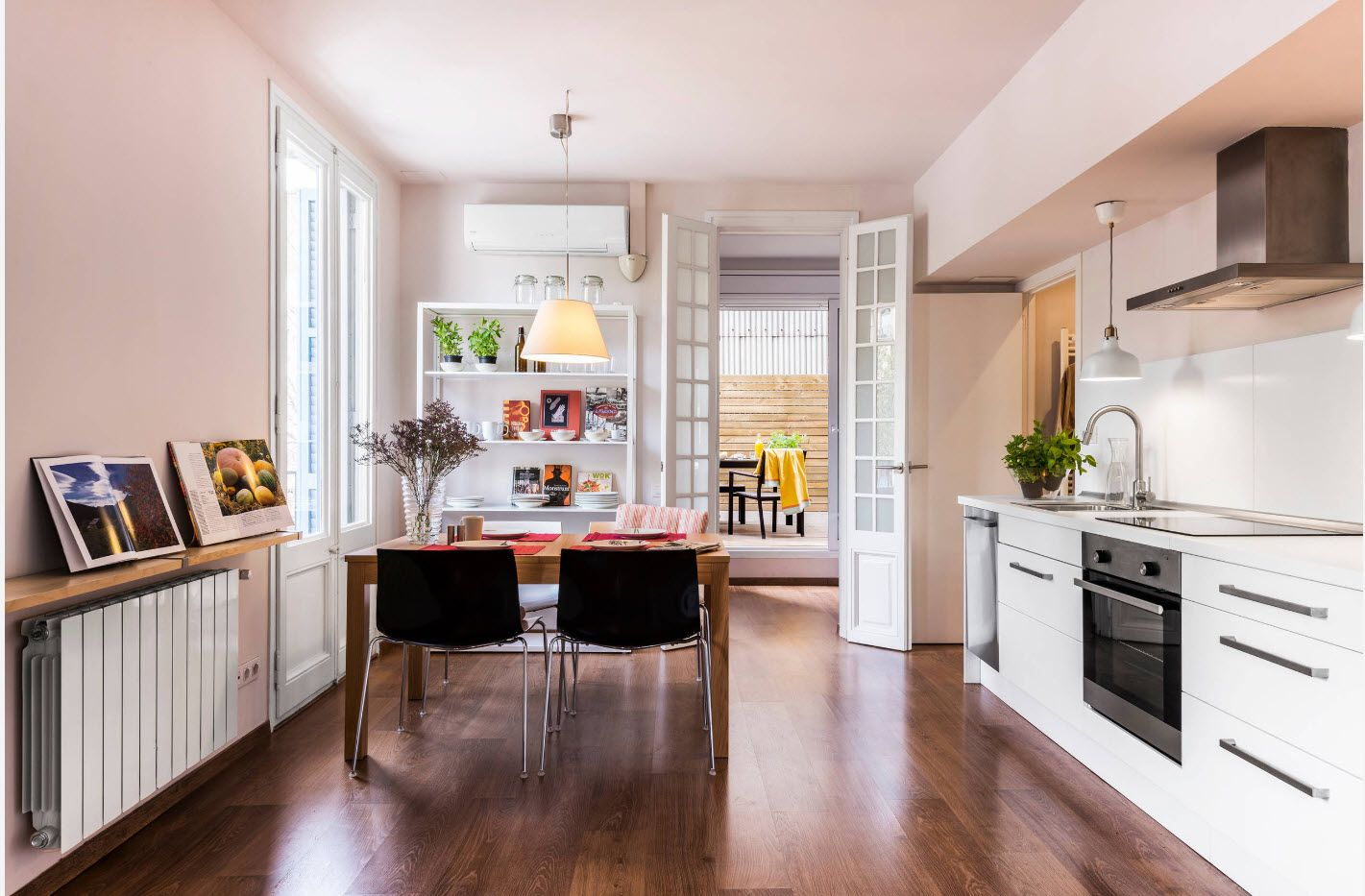 Modern dining room open layout with parquet and full of light