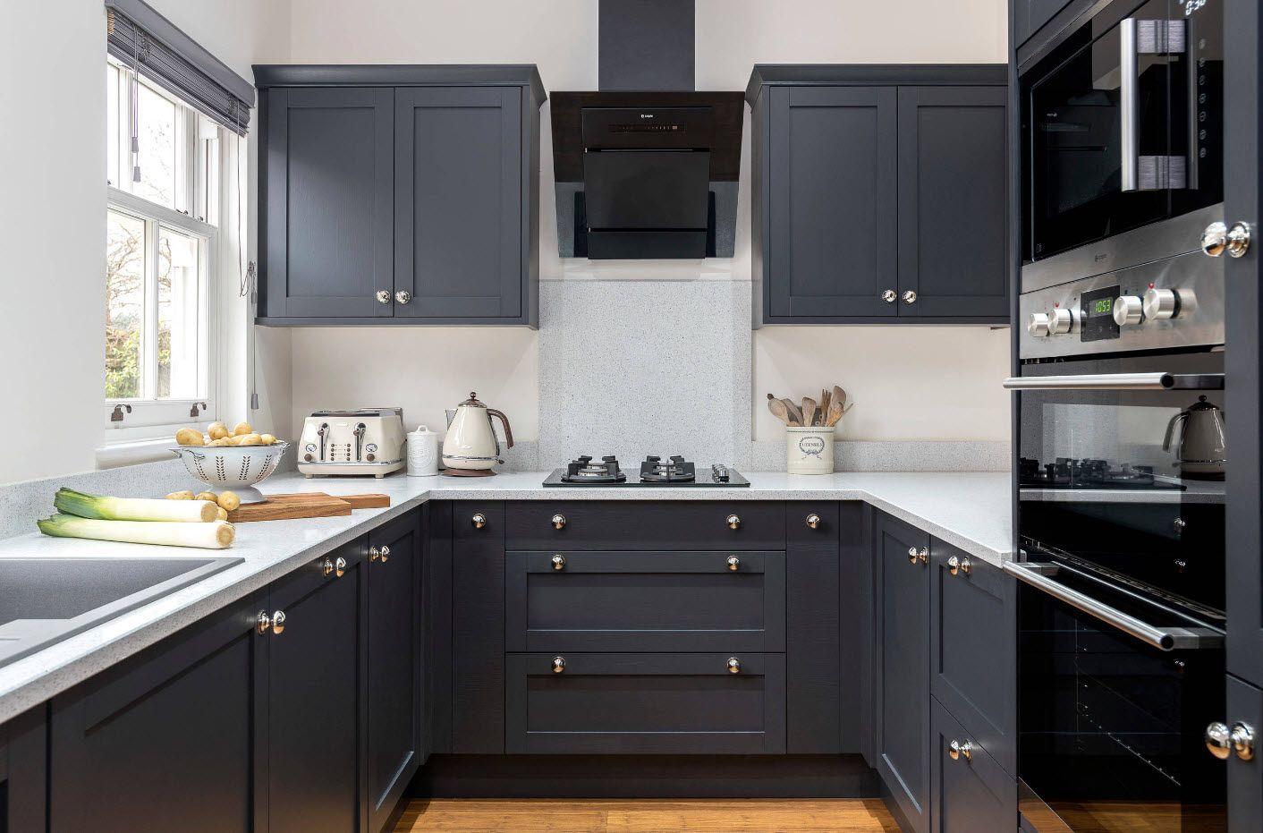 Dark wooden kitchen furniture set with gold handles looks spectacular