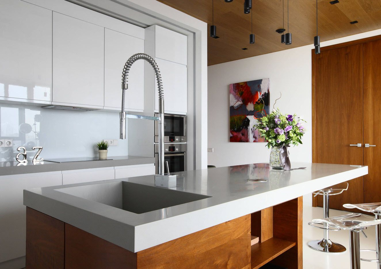 Wooden design in the modern private house's kitchen with mix of materials