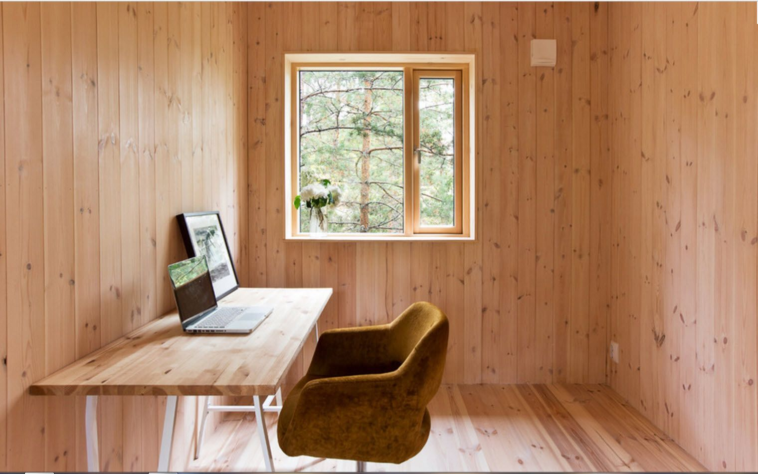totally wooden okanked home office with natural sight out of the window