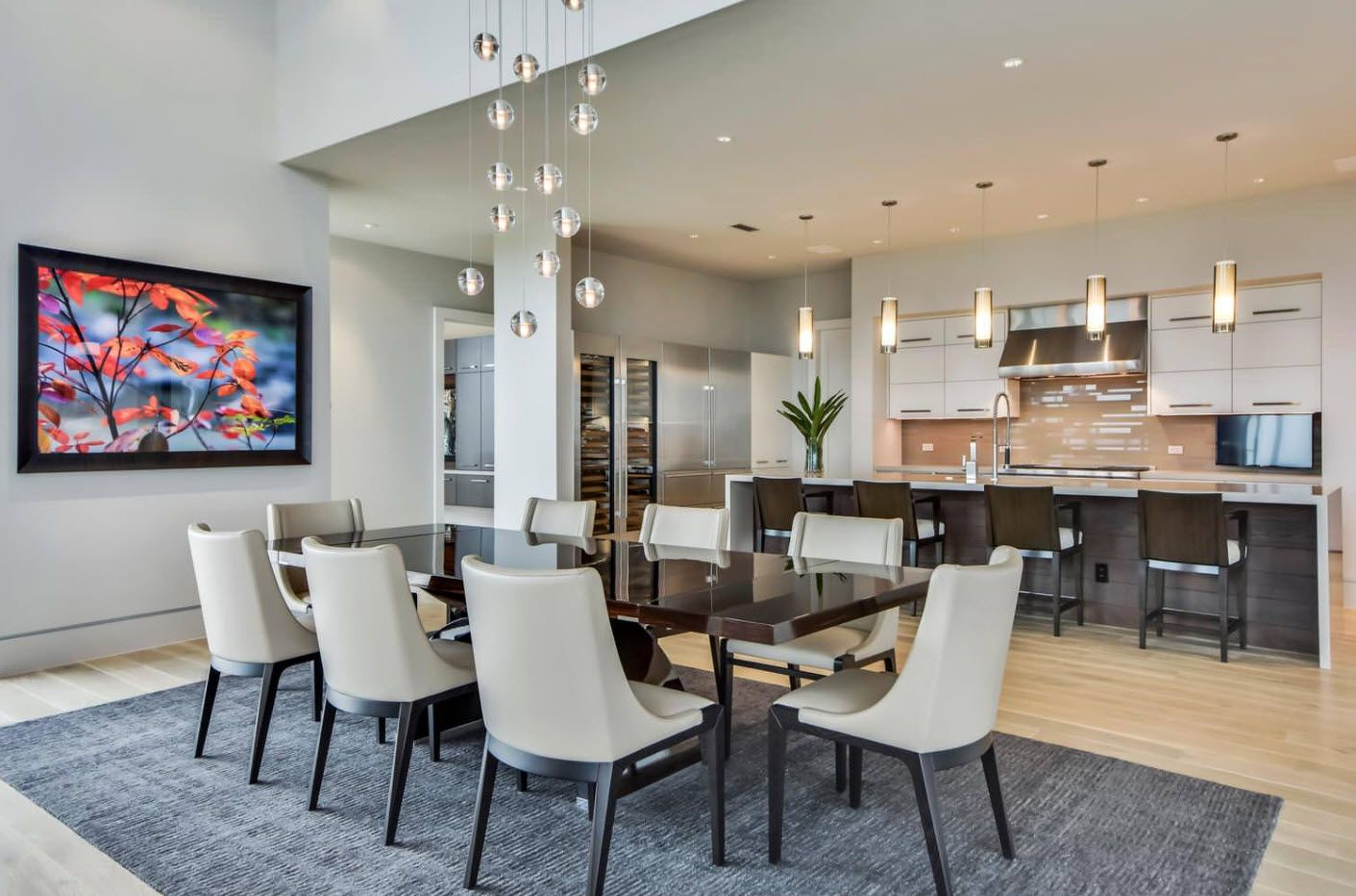 Modern dining room at the cotatge with coffee color upholstered chairs