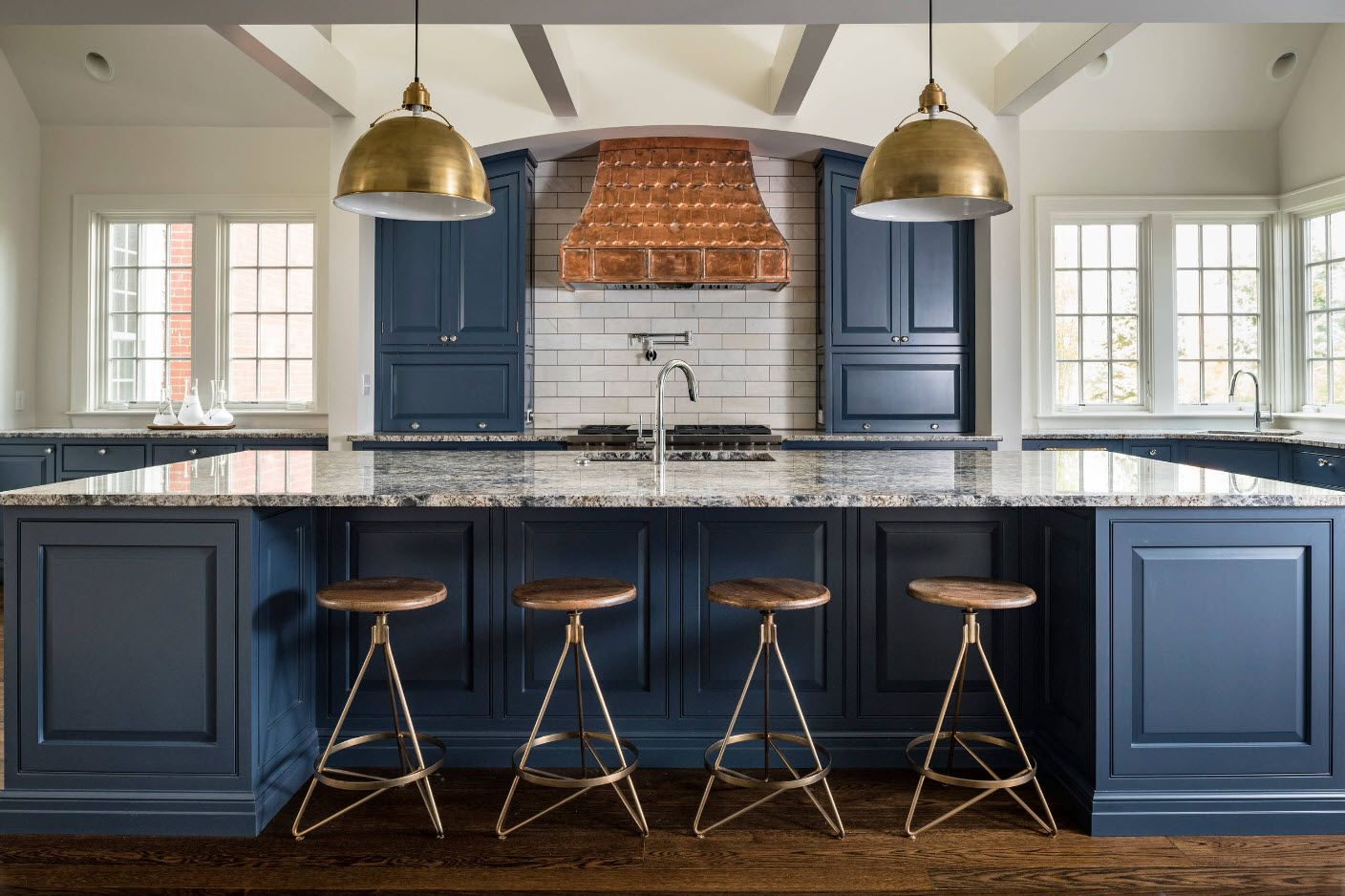 Classic dining room with set of wooden stools and dark blue finish of furniture facades