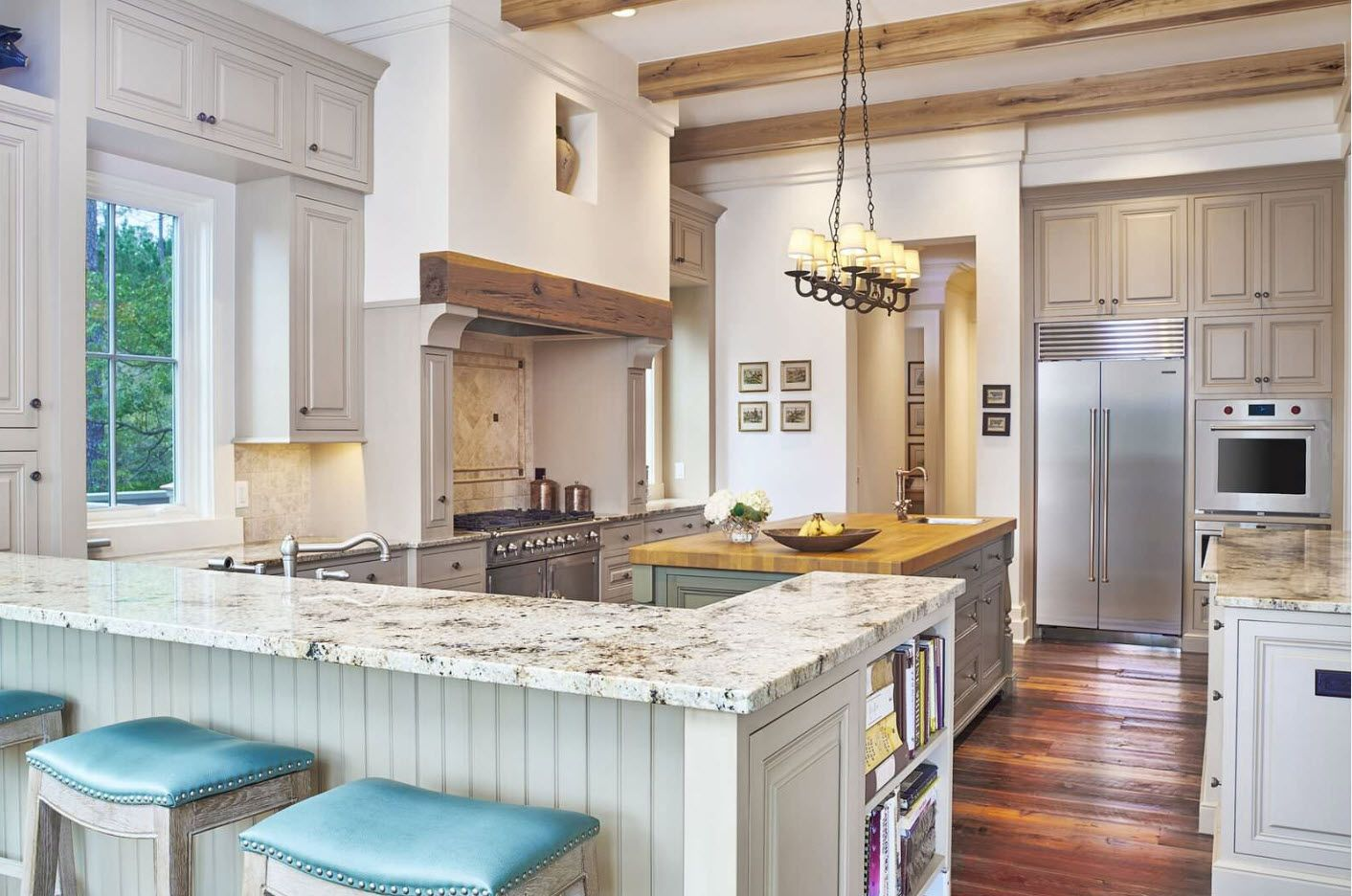 Provence styled kitchen with marble countertops and wooden beams