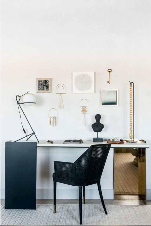 Black plastic table for the working area in the apartment's home office