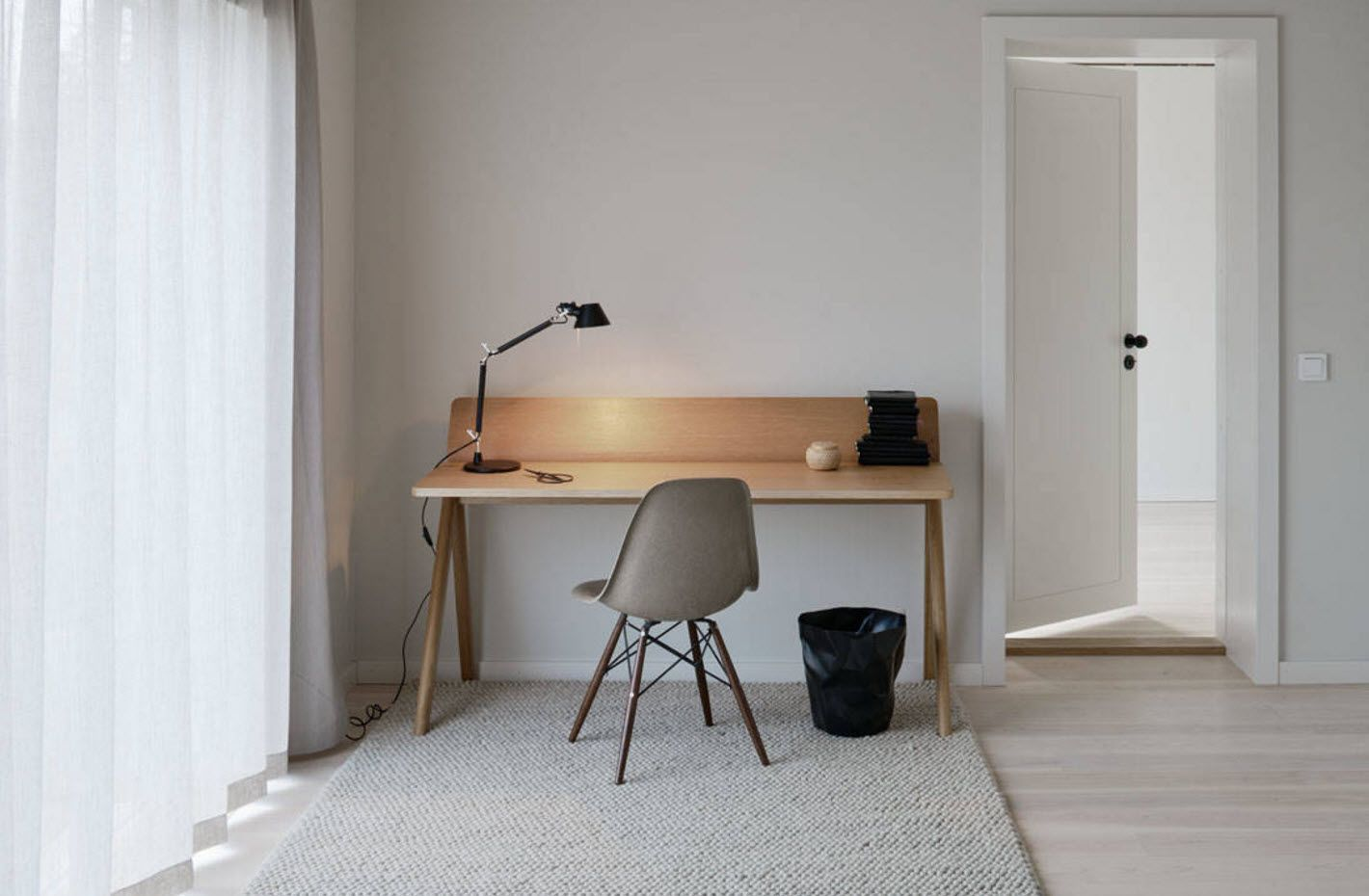 Dream working space with wooden table and black bin