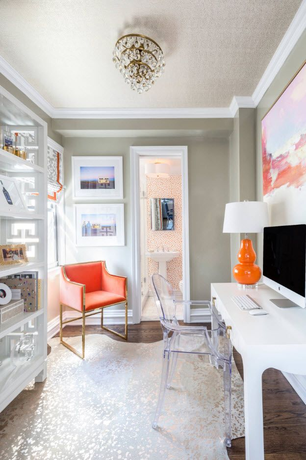 Gray decoration and bright orange accents to dilute calming atmosphere with creative elements