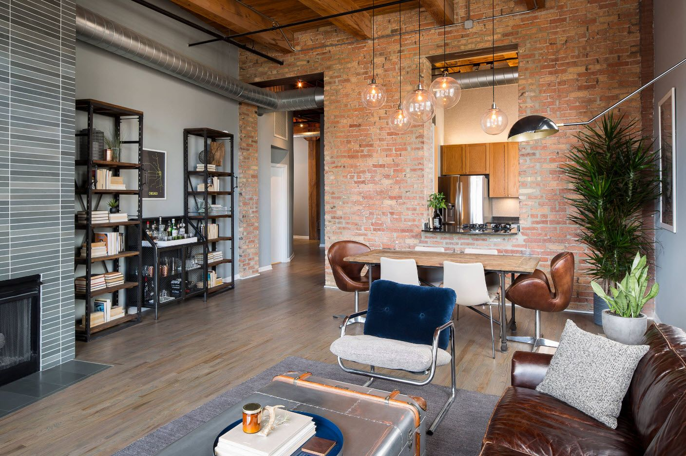 Brightly expressed loft style with suspended lamps and brickwork