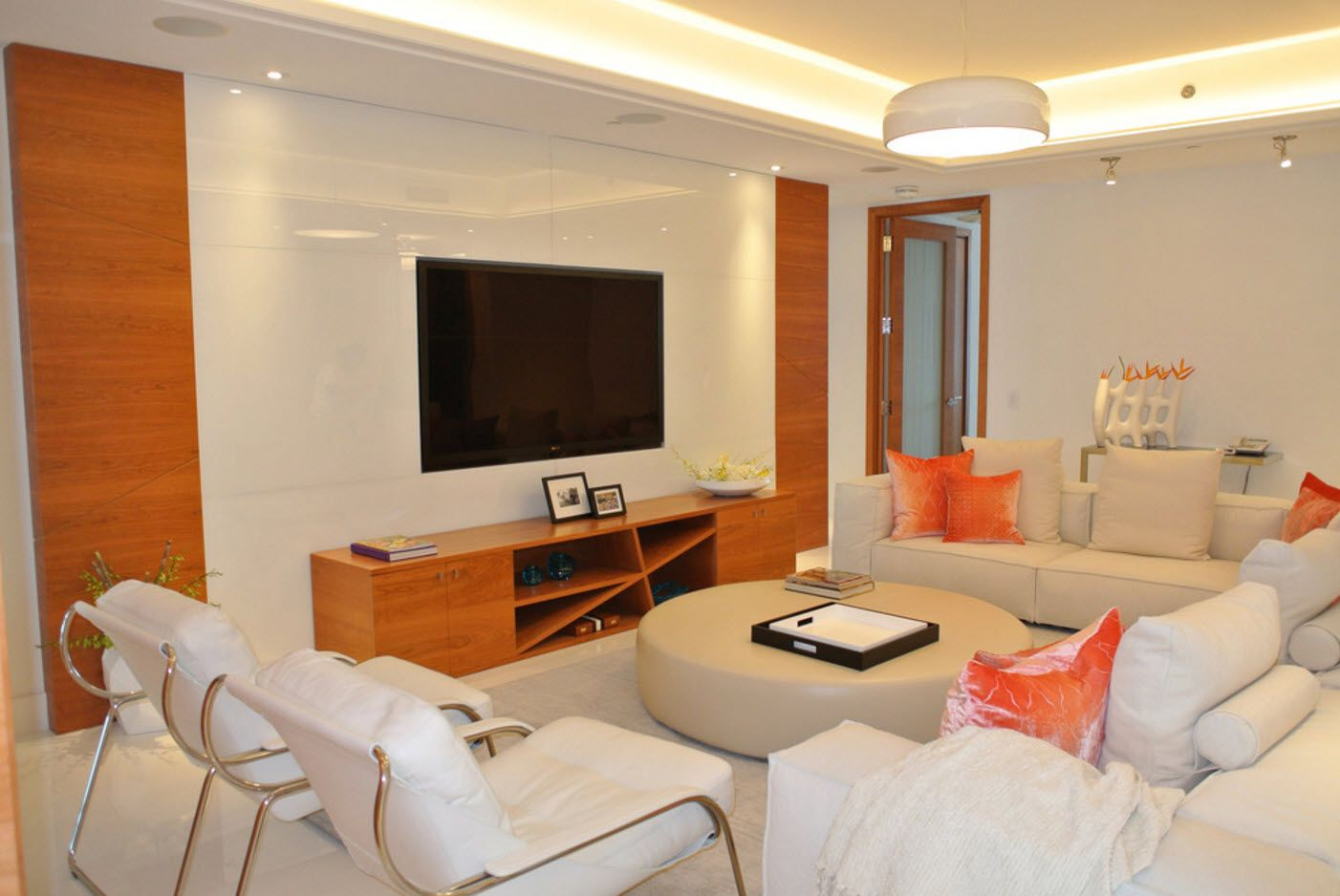 Wooden storage shelving and TV-set at the modern living with white furniture
