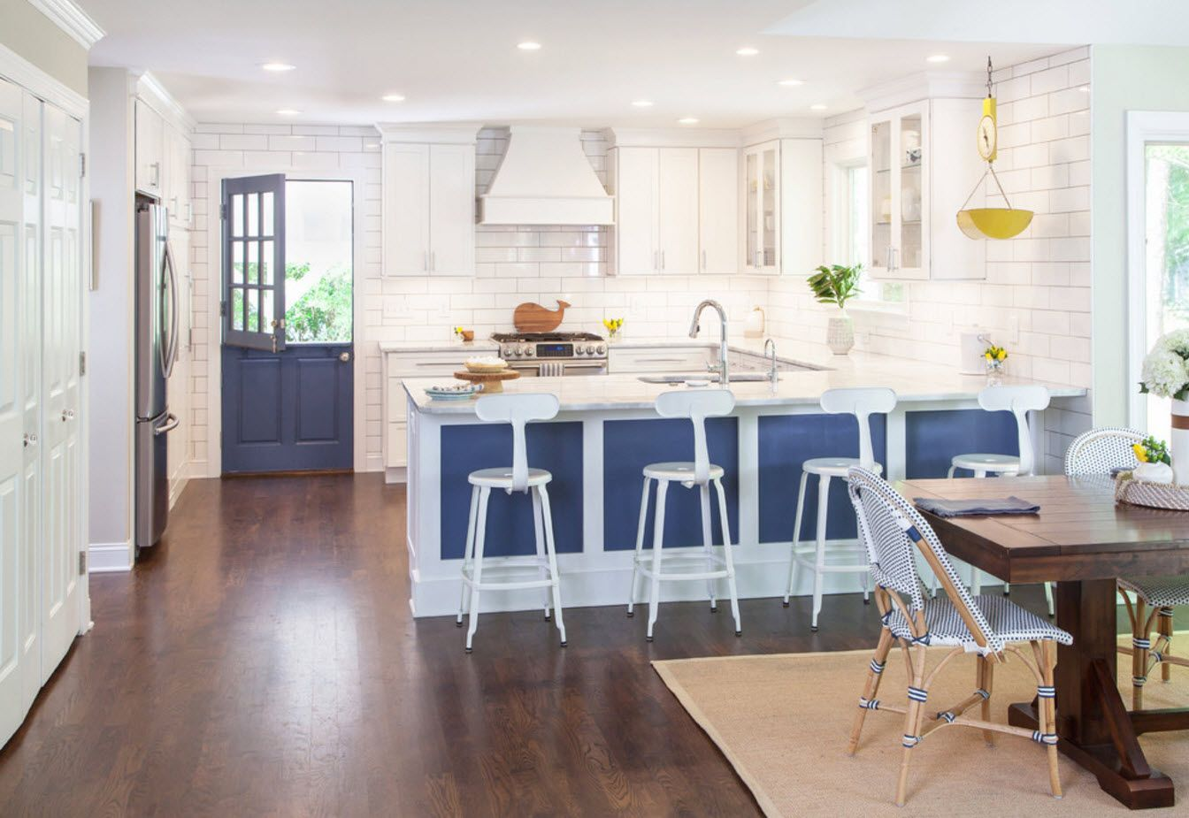 Blue design of the kitchen and snow-white atmosphere of the wall decoration with wooden floor