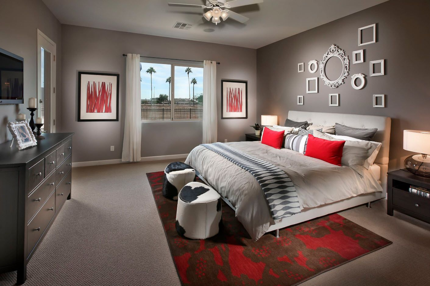 Red accents of pillows in the modern large bedroom
