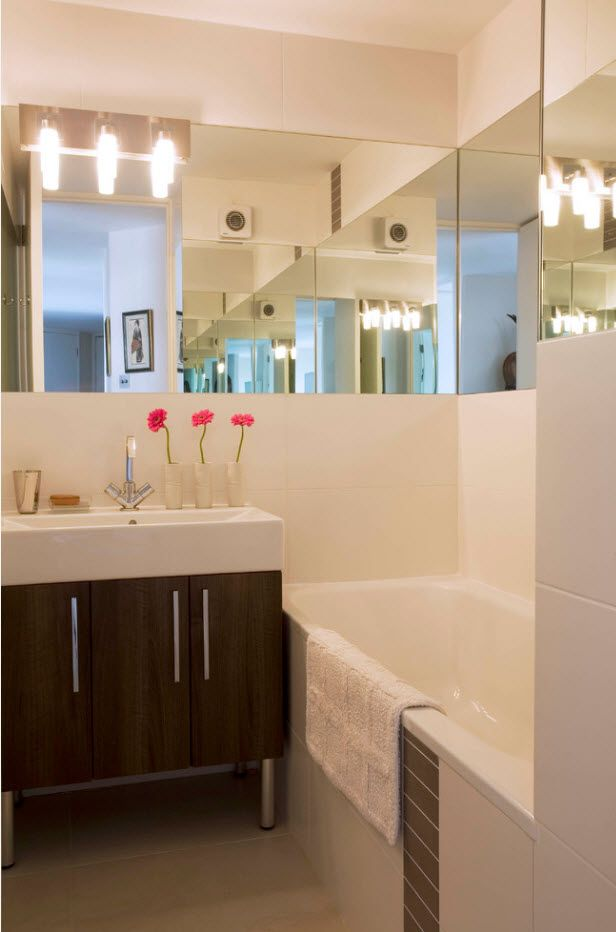Modern casual bathroom setting with pink accents