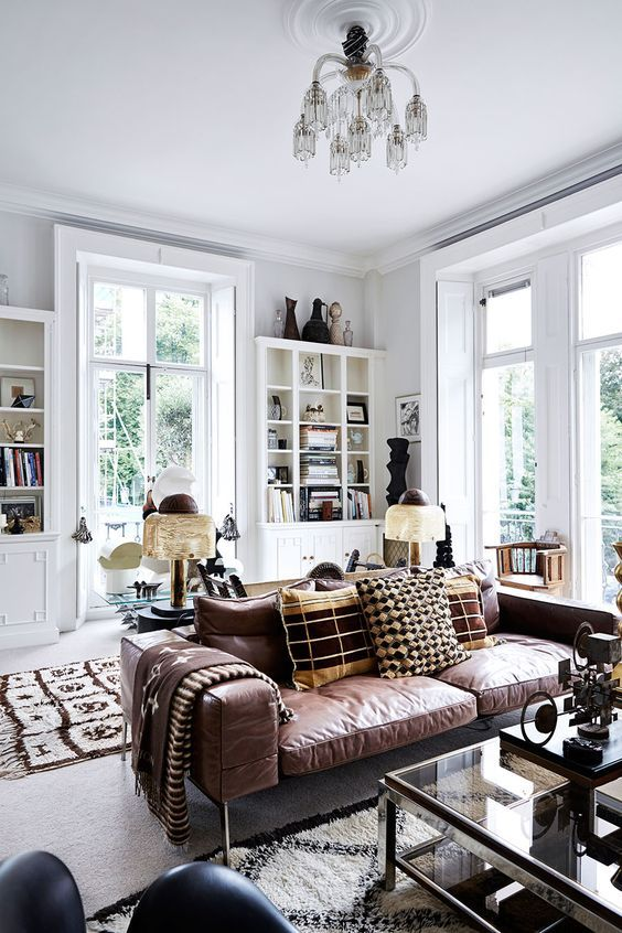 Vintage white interior with noble leather upholstered couch