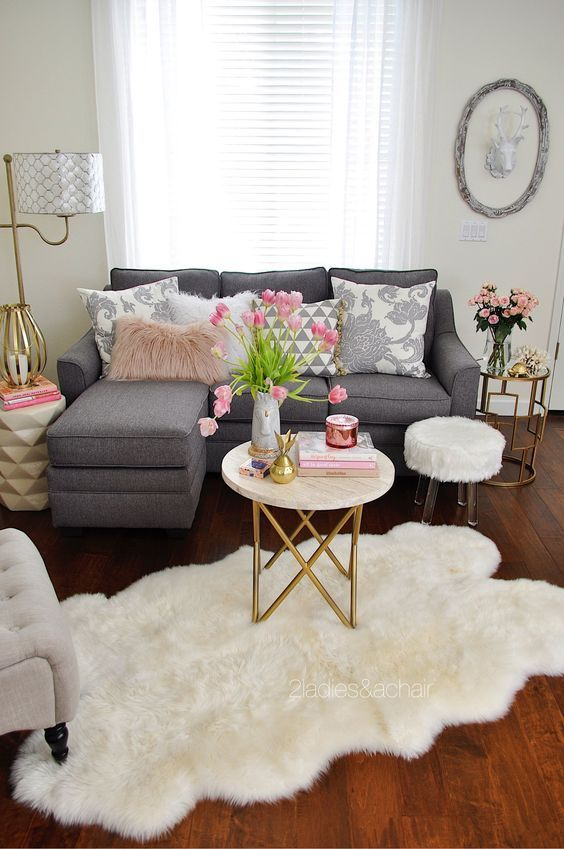 Shabby chic design for the modern living room with angular couch and pink accents