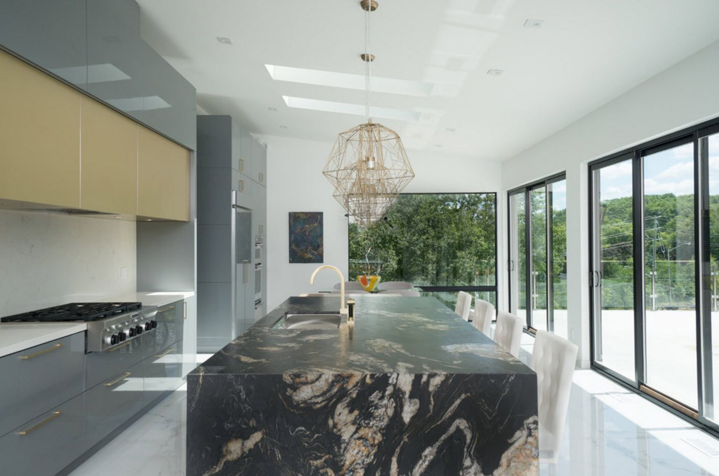 Nice dark marble imitation of the centered kitchen island at the large private house studio
