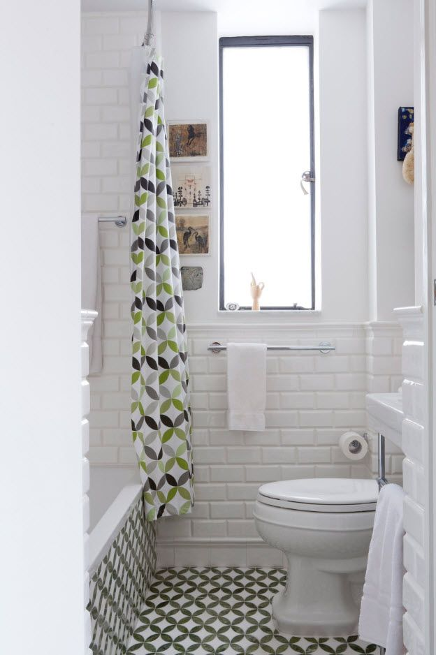 Classic setting of the bathroom with the plastic colorful curtain