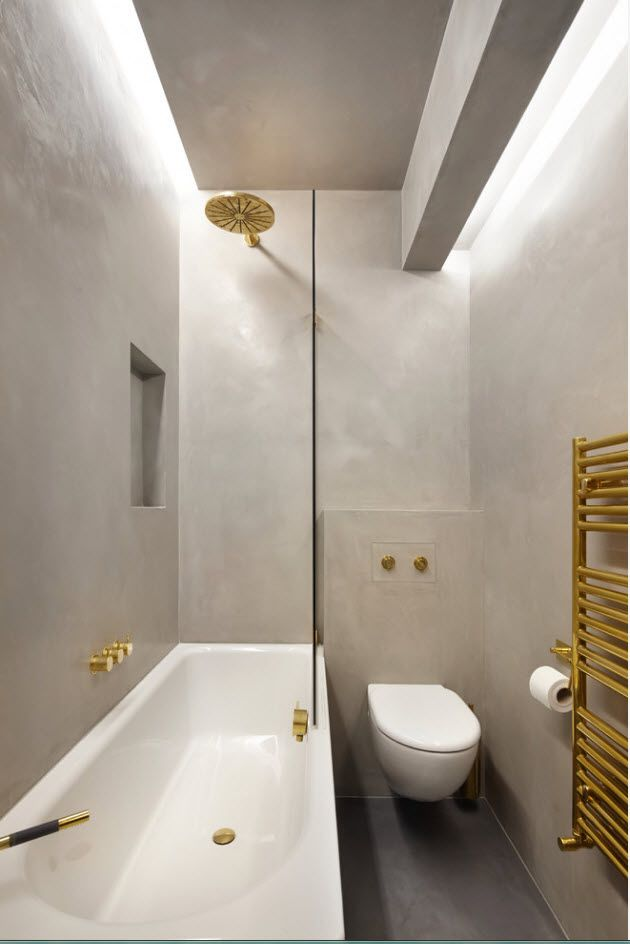 Gray bathroom walls and gold inclusions