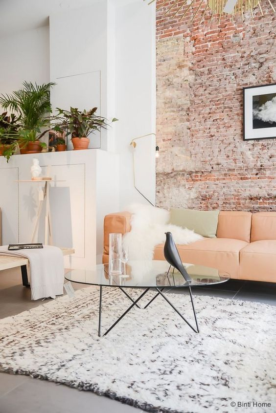 100+ Photo Modern Living Room Decoration Ideas. Brickwork and peachy leather upholstered couch