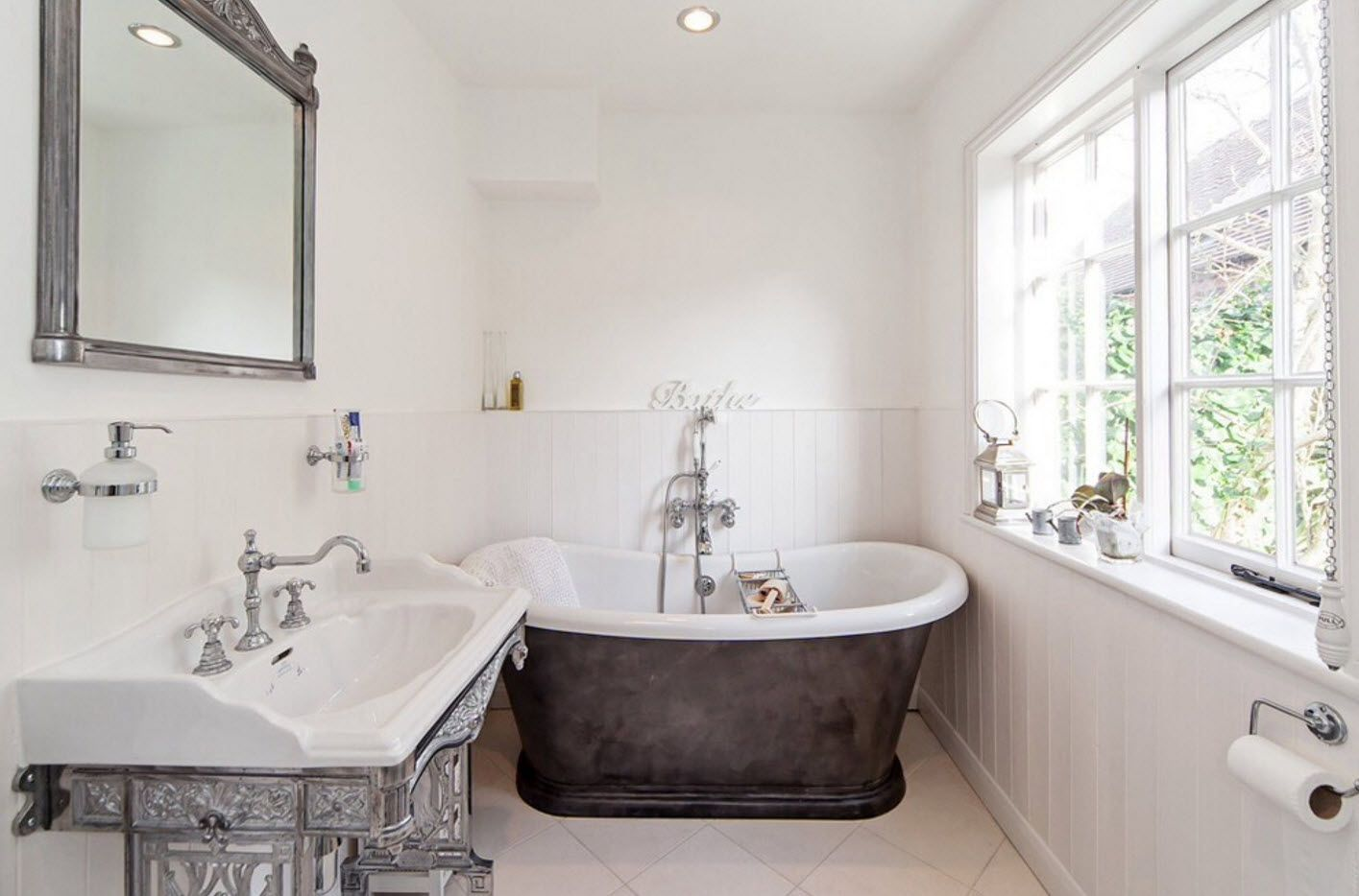 Classic bathtub and sanitary ware in the bathroom