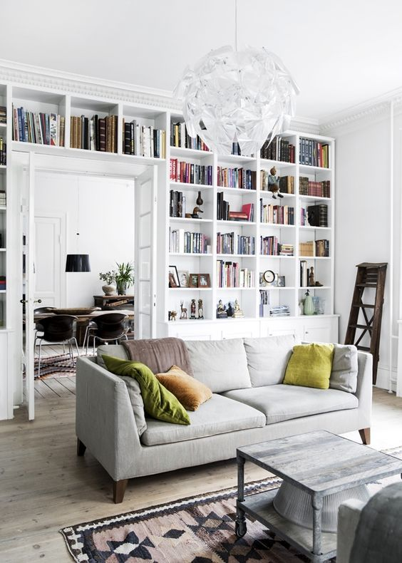 100+ Photo Modern Living Room Decoration Ideas. Ceiling high shelving full of books
