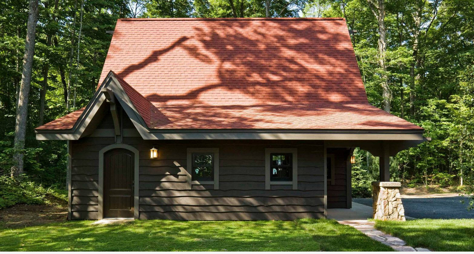 Forest small cottage with large roof