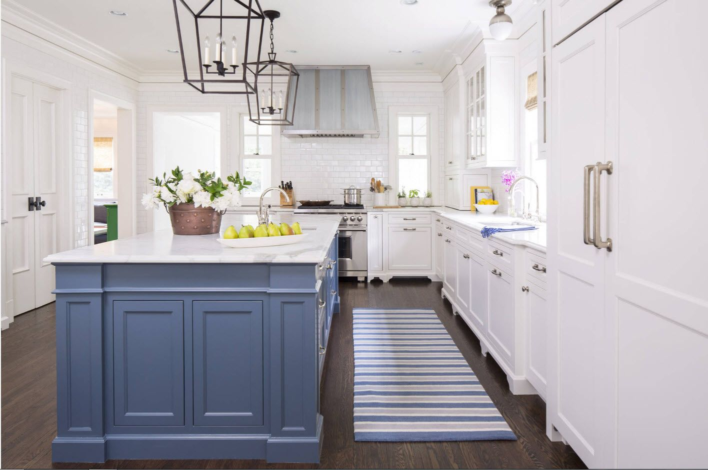square of the kitchen island and caged lampshades