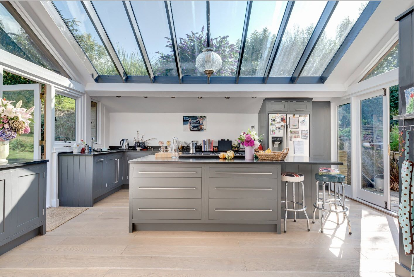 Glass roof at the kitchen with large island of modern private house