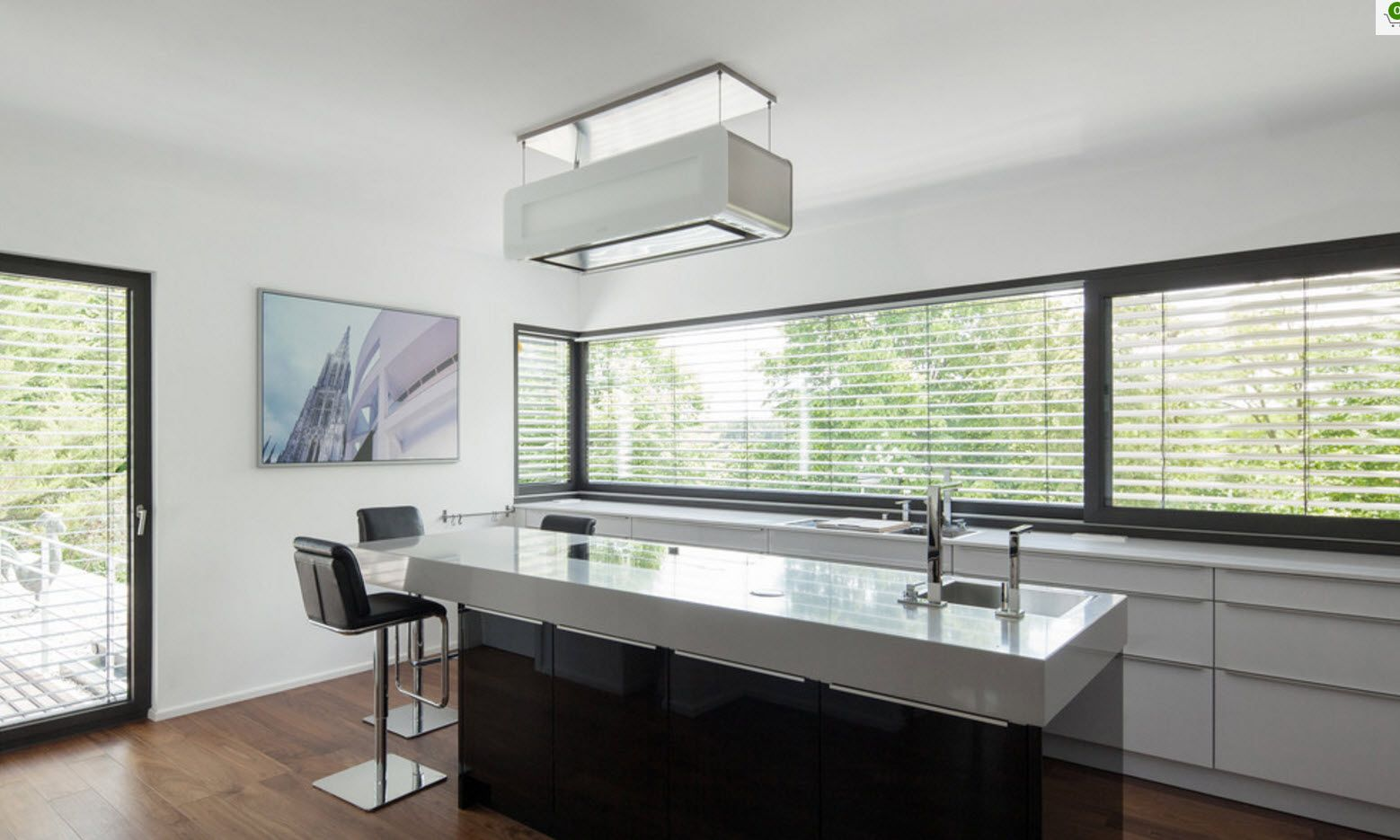 Panoramic long window and the kitchen island with the stone sink