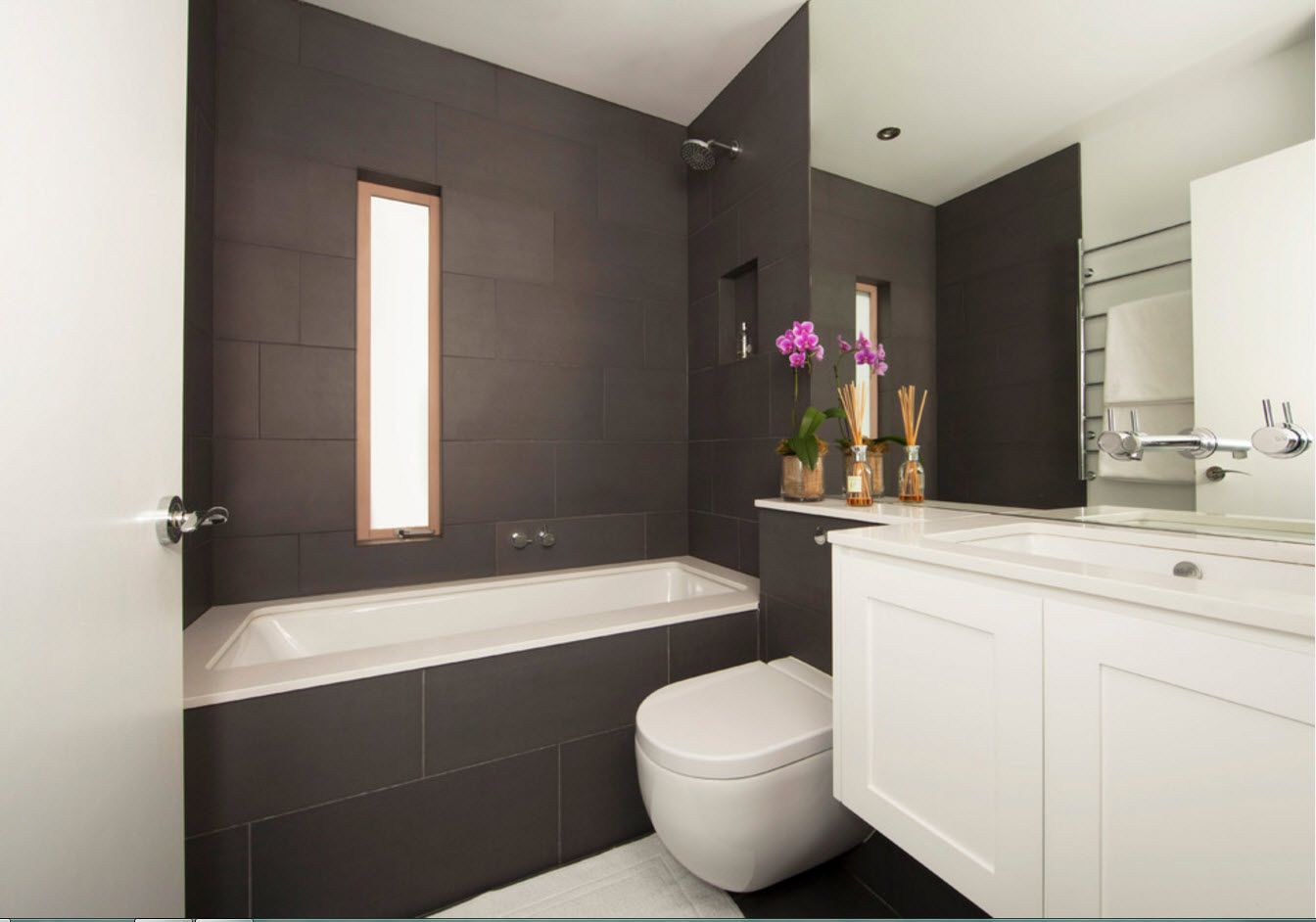 Solid design of the bathroom with graphite walls