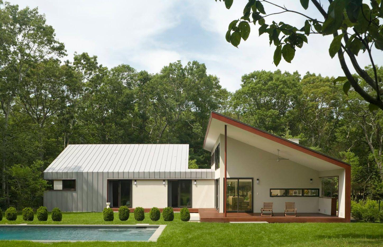 Stunning hi-tech design for the slant roofed modern cottage in white color