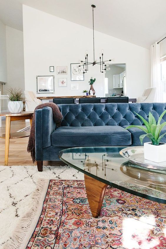 Cvintage design notes in the white set living with quilted blue couch