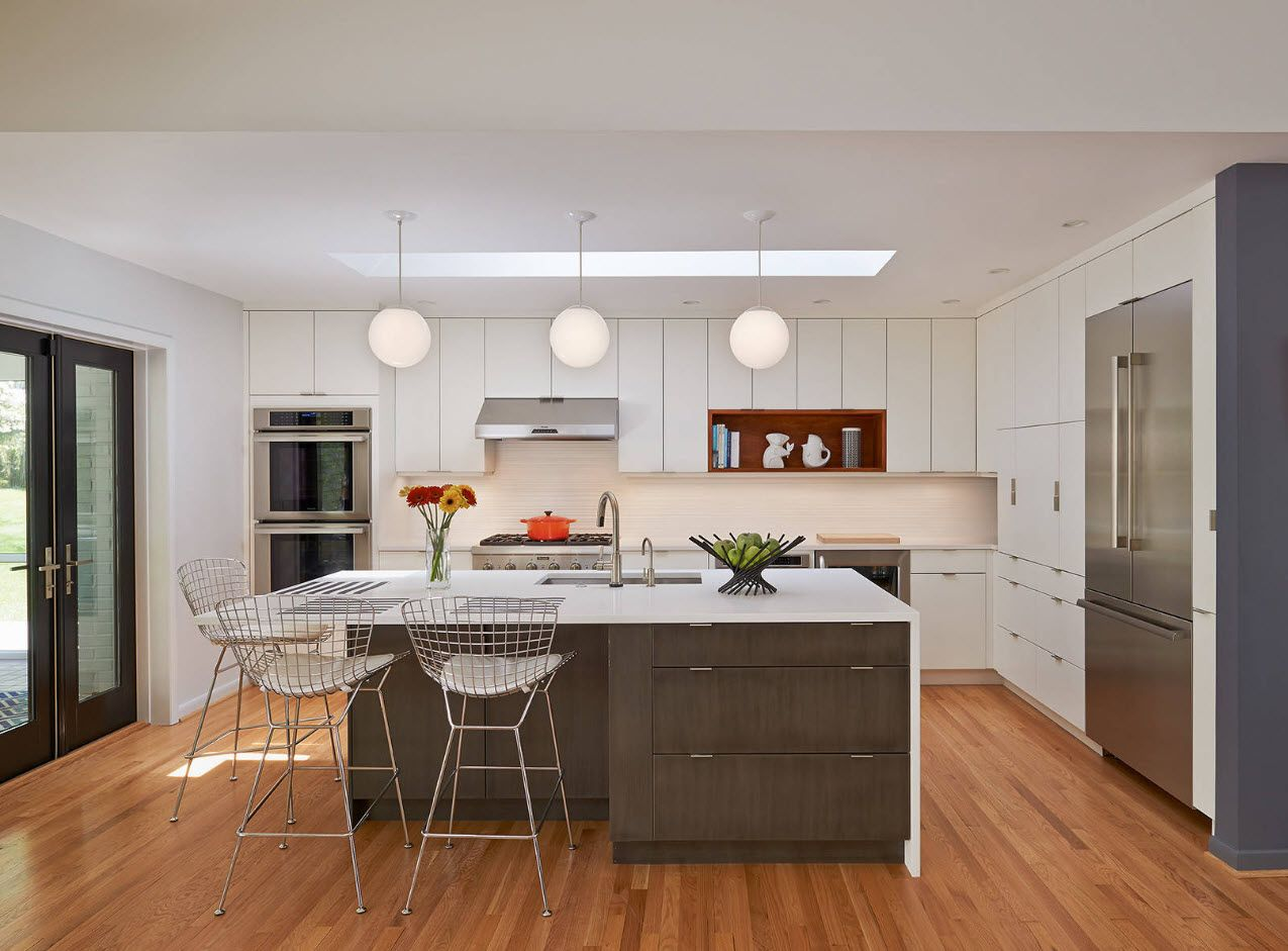 Bulb lampshades at the hi-tech styled kitchen with light wooden floor
