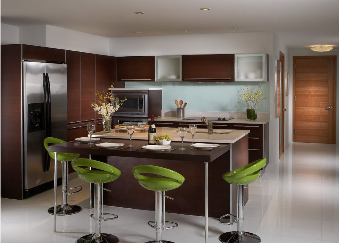 Green accent spots in the modern large private house's kitchen