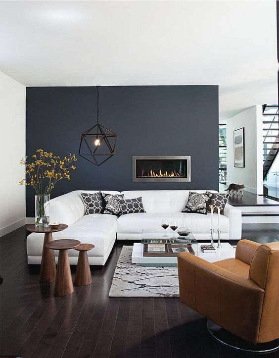 dark accent wall in the minimalsitic styled modern room