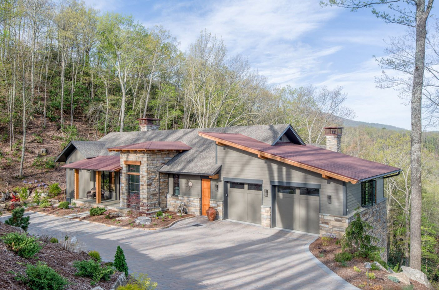 Saw-tooth and gabled roof of gray one-storey cozy cottage