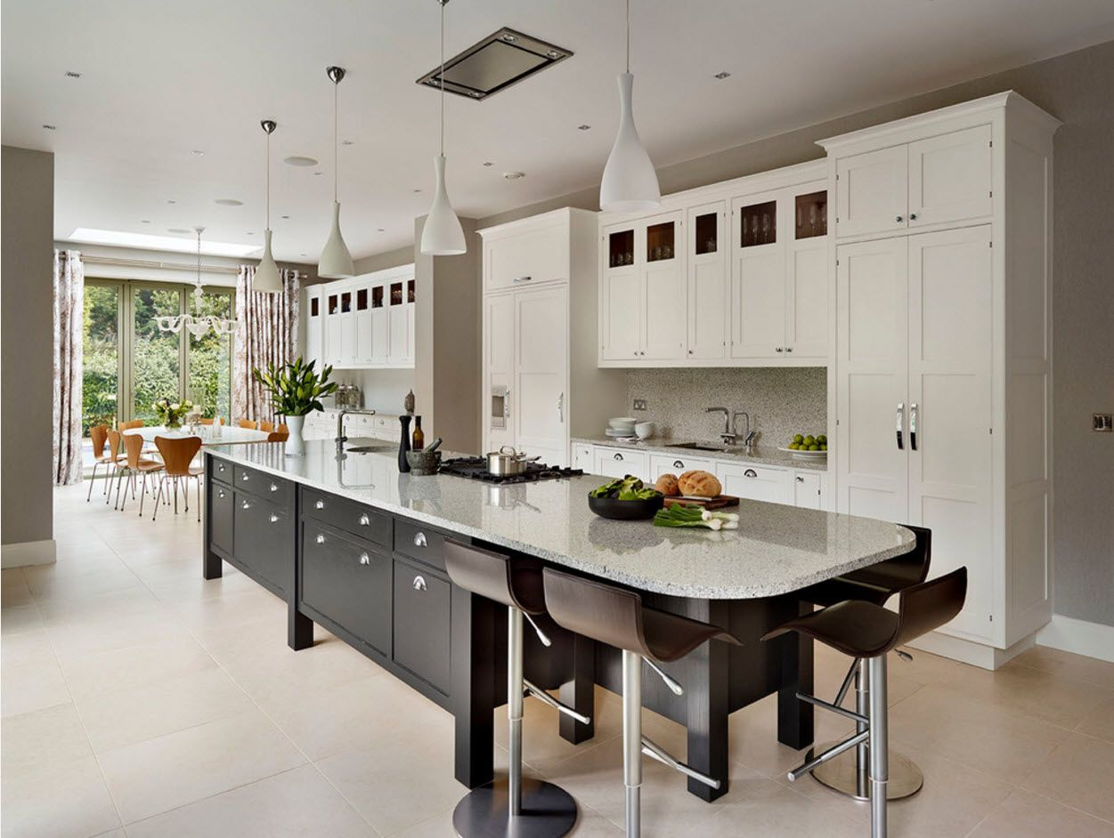 White linear layout of the kitchen furniture with long island