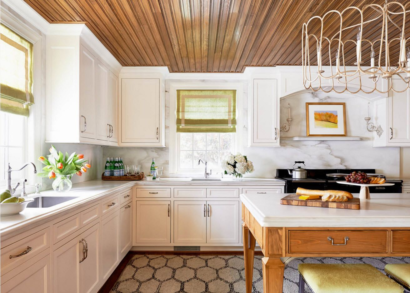 Planked wooden ceiling in light Provence styled kitchen