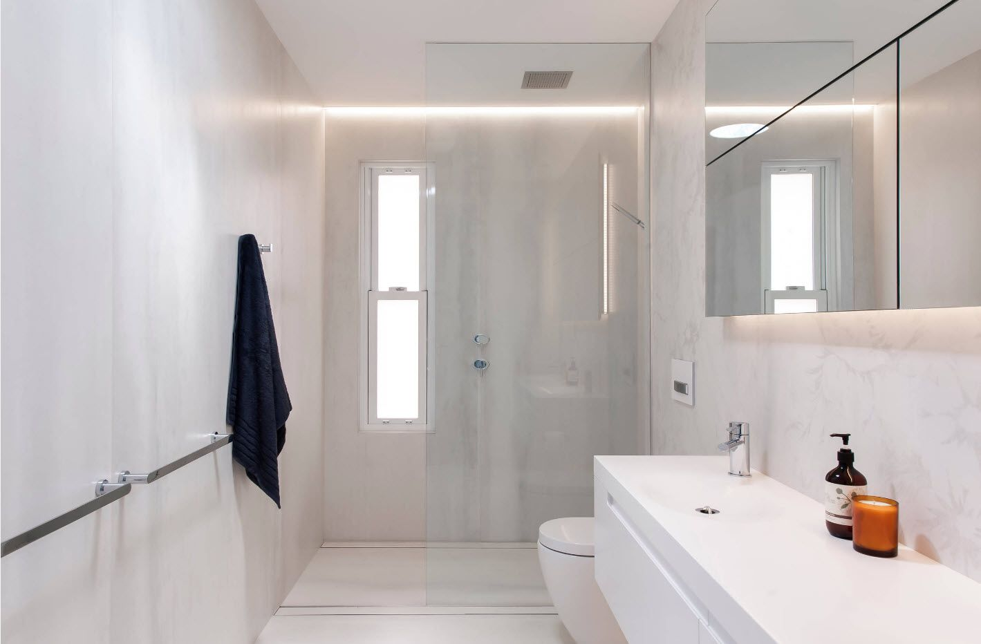 Light color trimming and nice backlighting at the modern bathroom