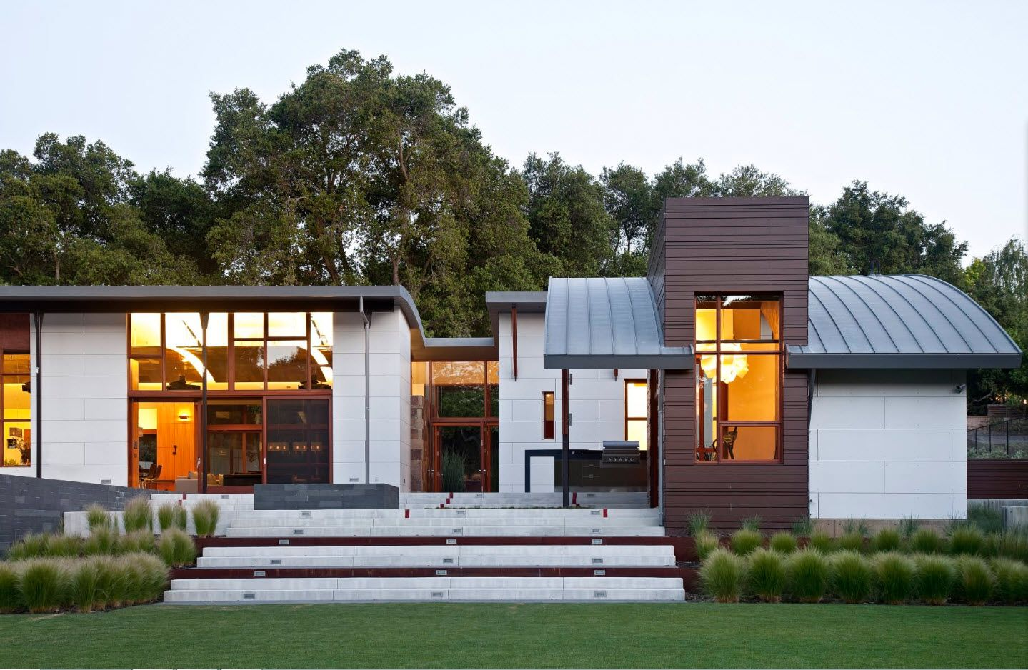 Complex of different style buildings in one composition of suburb spectacular cottage
