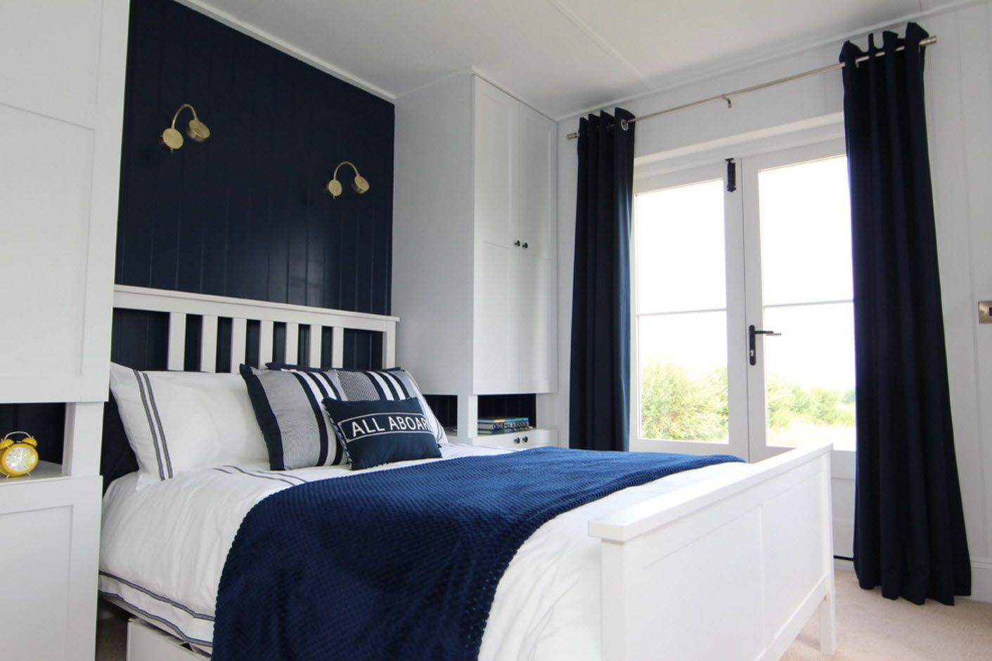 Marine style touch with deep blue accent wall and linen