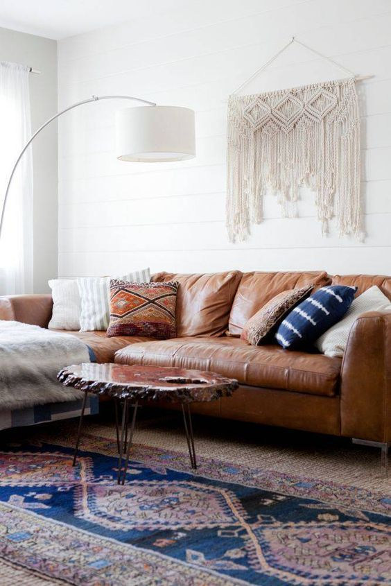 Scandinavain minimalism with standing vault lamp and leather couch
