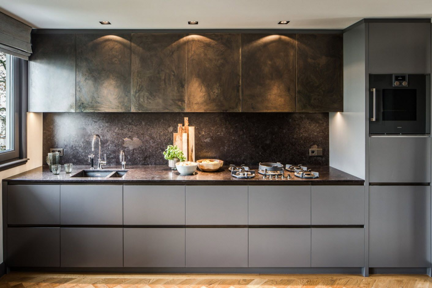 Unusual backlighting for the modern kitchen with dark wooden surfaces