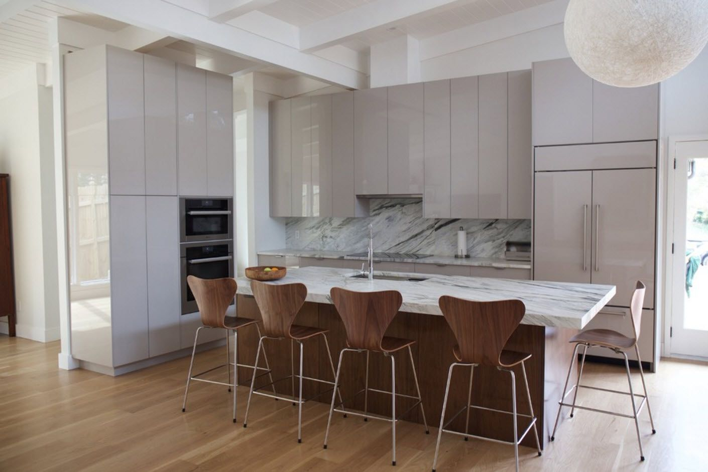 Nice molk chocolate wooden texture and color of chairs and kitchen island sides