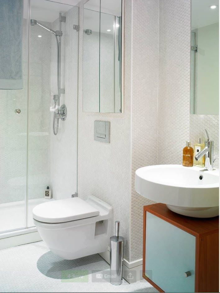 White walls and plumbing in the modern styled bathroom with classic wooden vanity