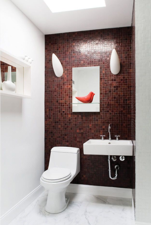 dark red wall tiled with mosaic in the toilet